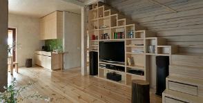 Как «обжить» пространство под лестницей: 5 идей