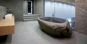 Чем хороши ванны из нестандартных материалов