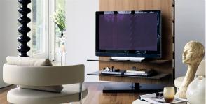 Как вписать телевизор в интерьер гостиной